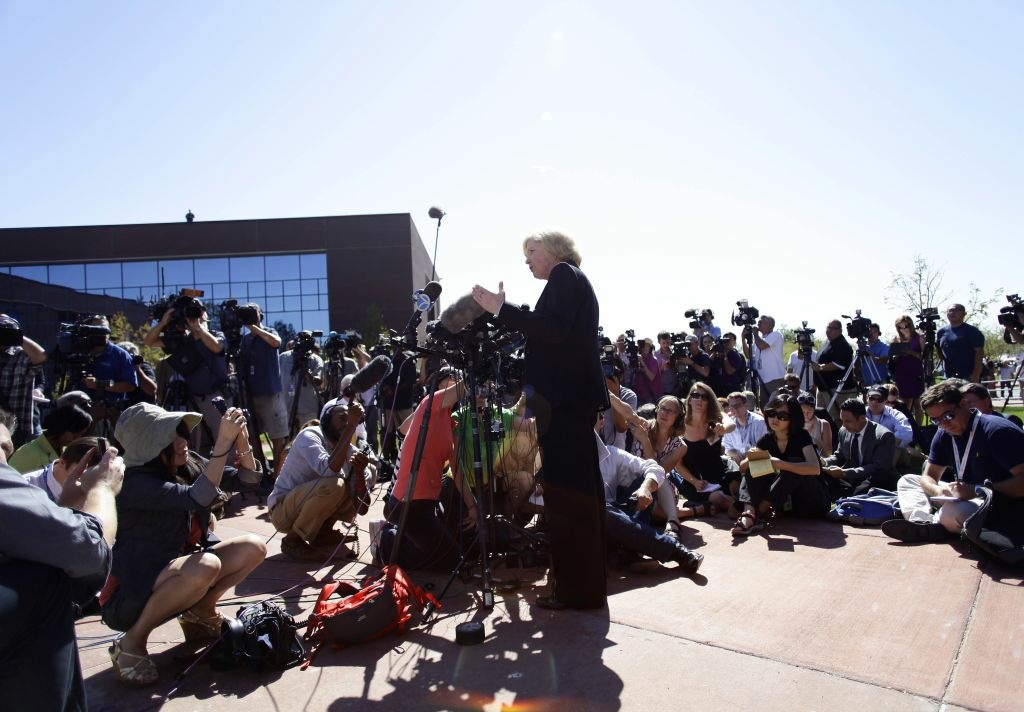 Arapahoe County District Attorney Carol Chambers talks to members of the news media before heading into the Arapahoe County Courthouse for suspect James Holmes' first court appearance July 23, 2012 in Centennial, Colorado.
