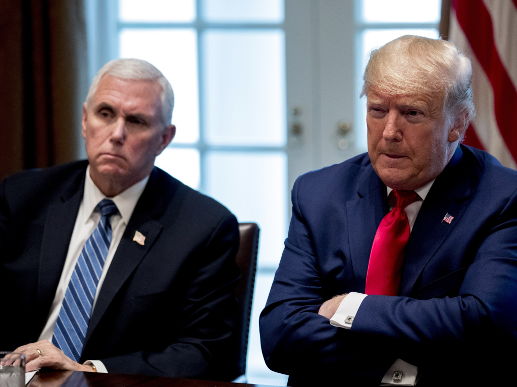 President Donald Trump and Vice President Mike Pence, left, attend a meeting with pharmaceutical executives on the coronavirus in the Cabinet Room of the White House on Monday.