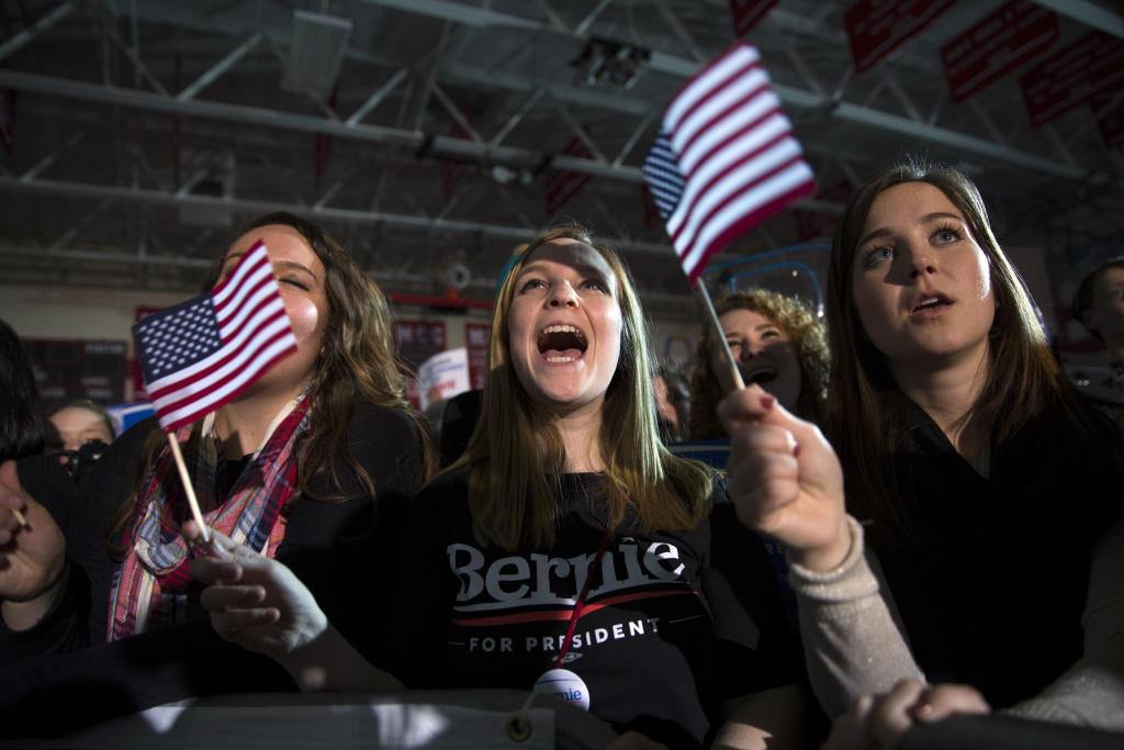 Kelsey Johnson of Greensburg, Ind., cheers as Democratic presidential candidate Sen. Bernie Sanders, I-Vt., speaks during a campaign rally at Grand View University, on Sunday, Jan. 31, 2016, in Des Moines, Iowa. (AP Photo/Evan Vucci)