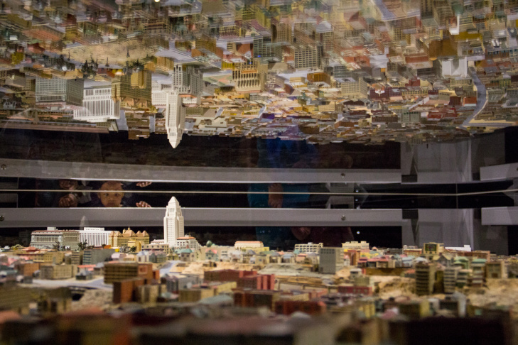 A team of City Planning Department model makers, drafters and architects surveyed downtown Los Angeles between 1938 and 1940 and built a model, of which this is a small part, at the Natural History Museum's new exhibit,