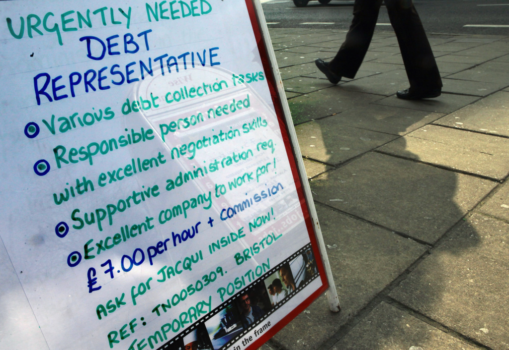 A vacancy sign looking for debt collectors outside a recruitment job shop in Bristol, England, 2009.