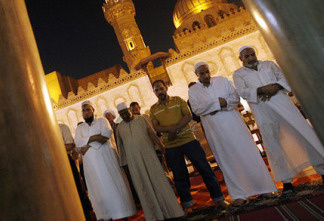 Muslim Egyptian men pray during the Islamic holy month of Ramadan at Cairo's historic Al-Azhar mosque in September 2009. Some experts say many Egyptians have lost the meaning of the holy month, spending too much time after hours partying, eating and watching TV.