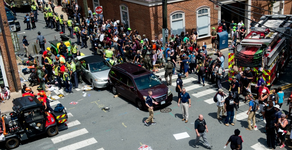 People receive first-aid after a car ran into a crowd of counter protesters in Charlottesville, Virginia on August 12, 2017.