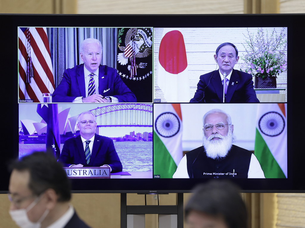 President Joe Biden, Japanese Prime Minister Yoshihide Suga (top right), Scott Morrison, Australia's prime minister (bottom left) and Indian Prime Minister Narendra Modi seen on a monitor during the virtual Quadrilateral Security Dialogue or Quad meeting, at Suga's official residence in Tokyo on Friday.