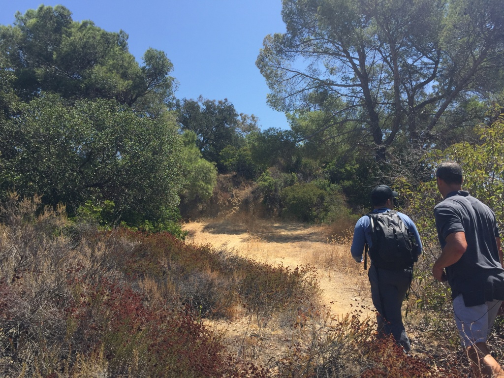 Miguel Ordeñana and A Martinez hike up to one of Ordeñana's cameras in Griffith Park.