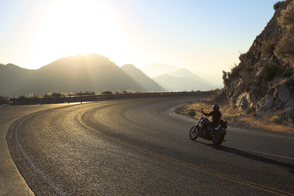 LOS ANGELES, CA - OCTOBER 2:  A motorcyclist rides the Angeles Crest Highway (State Route 2) in the Angeles National Forest on October 2, 2013 in the San Gabriel Mountains, northeast of Los Angeles, California. The Angeles Crest Highway (State Route 2) remains open but campgrounds and other recreation areas as well as services within the Angeles National Forest are closed for a second day due to the partial government shutdown as House Republicans demand that the Senate and President Obama give in to efforts to defund the Affordable Care Act law, also known as Obamacare.  (Photo by David McNew/Getty Images)