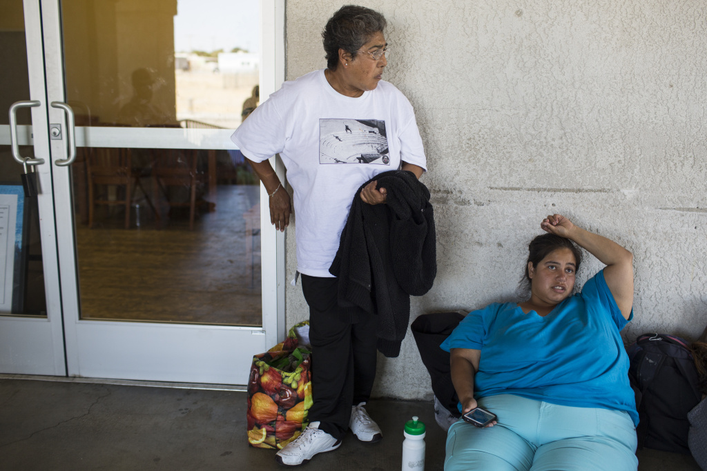 Women wait in line to get a bed for the night at Grace Resource Center's Lancaster Community Homeless Shelter on Tuesday afternoon, May 31, 2016. The shelter closed earlier this year.