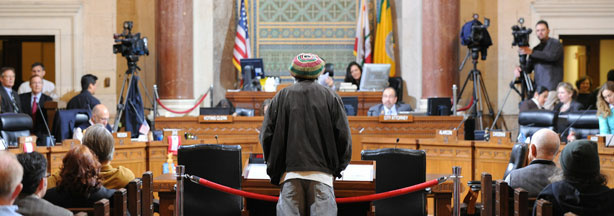 Medical marijuana advocate Ali Rashi gives his speech at a Los Angeles City Council meeting to debate changes to the access and distribution of the drug, in Los Angeles on Dec. 8, 2009.