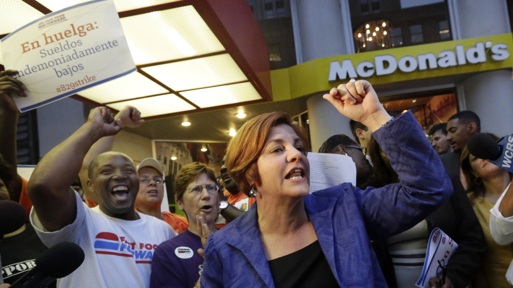New York City Council Speaker and mayoral candidate Christine Quinn speaks at a fast-food workers' protest outside a McDonald's in New York in August. A nationwide movement is calling for raising the minimum hourly wage for fast-food workers to $15.