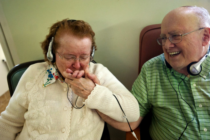 Marcie, 85, and Tom H., 84, listen to music from an iPod on Thursday, Jan. 24 at Atherton Baptist Homes in Alhambra. Marcie is one of several residents with dementia who is part of Atherton's Music & Memory program.