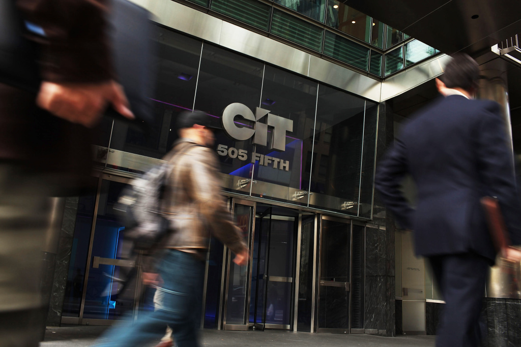 File: People walk by the headquarters of CIT Group on Nov. 2, 2009 in New York City.