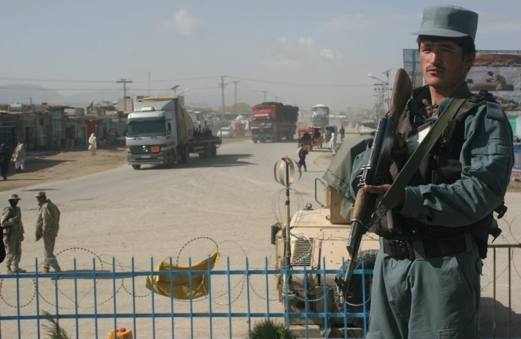 An Afghan police officer stands guard near the site where a suicide bomb attack took the life of six Americans, including 25-year-old Foreign Service officer Anne Smedinghoff, in Afghanistan on Saturday.