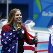 USA's Lilly King (L) poses with her gold medal next to silver medalist Russia's Yulia Efimova after she won the Women's 100m Breaststroke Final during the swimming event at the Rio 2016 Olympic Games at the Olympic Aquatics Stadium in Rio de Janeiro on August 8, 2016.