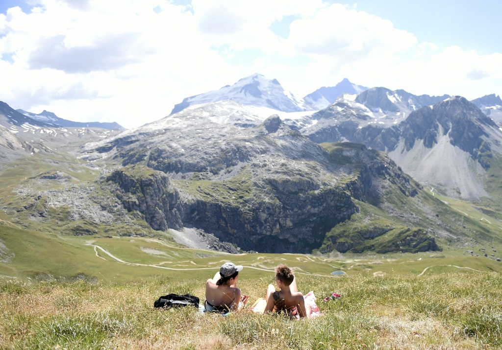 Women sunbathe in Tignes, southeastern France, on July 21, 2015.