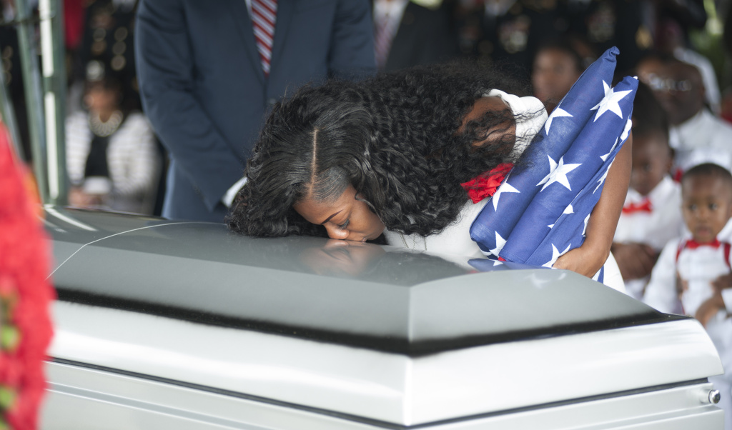 Myeshia Johnson kisses the casket of her husband Army Sgt. La David Johnson during his burial service on October 21, 2017 in Hollywood, Florida.