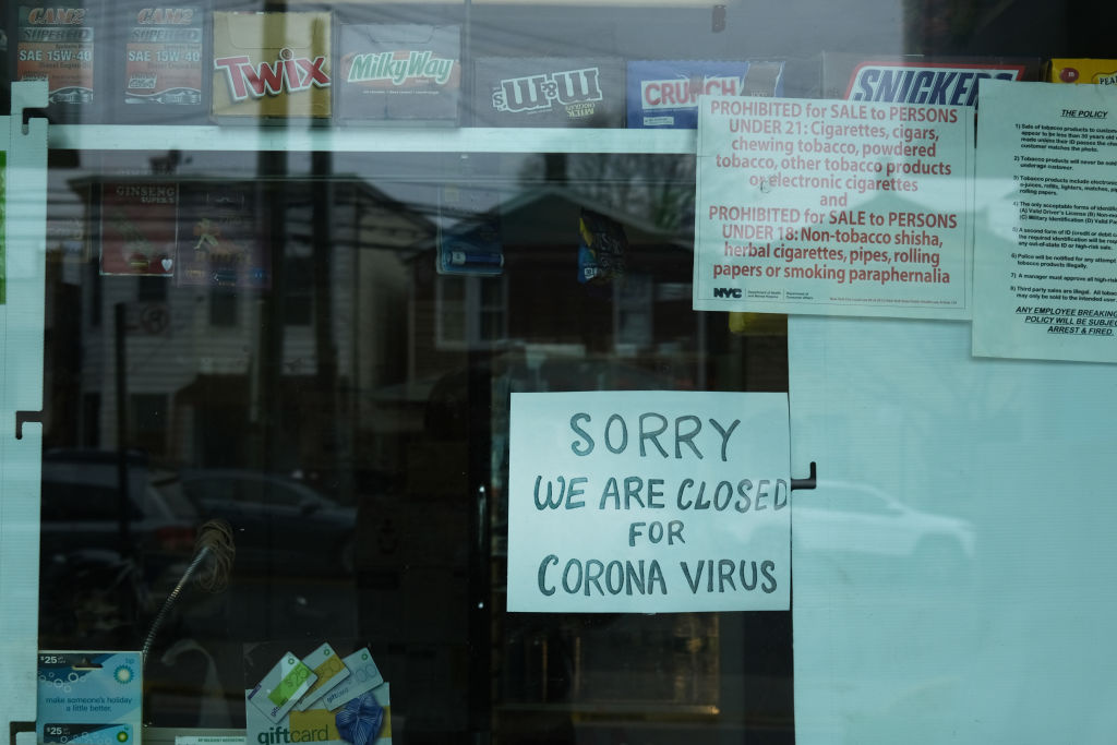 A sign alerts customers that a business is closed due to statewide coronvirus restrictions.