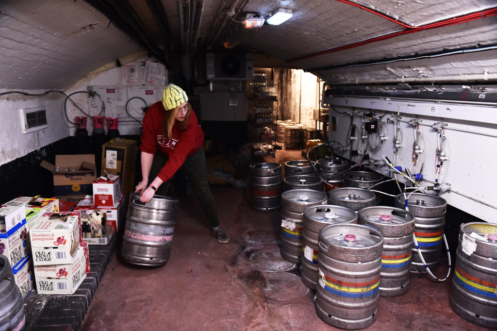 A employee of the White Horse Pub organizes  beer kegs in a cellar after the delivery from Joules Brewery on April 06, 2021 in Shrewsbury, England.