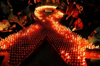 Indonesian volunteers light candles during a ceremony to mark World AIDS Day in Jakarta on December 1, 2009. There are estimated to be some 33.4 million people worldwide living with HIV/AIDS, with 2.7 million new cases each year.
