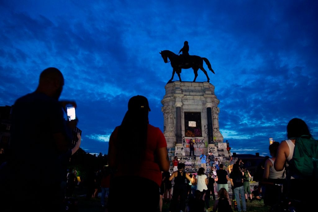 People gather around the Robert E. Lee statue on Monument Avenue in Richmond, Virginia, on June 4, 2020, amid continued protests over the death of George Floyd in police custody.