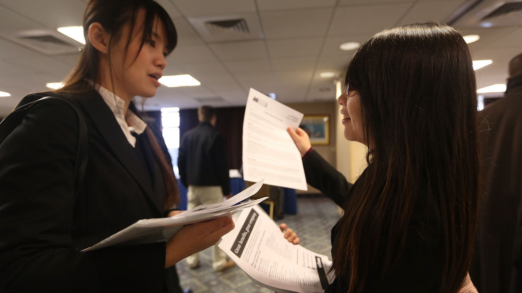 Li-Wen Hung (left) and Whitney Chen were waiting  to meet potential employers at a Manhattan job fair earlier this year.
