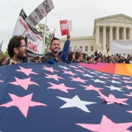 Protesters hold a pro-gay rights flag outside the US Supreme Court on April 25, 2015, countering the demonstrators who attended the March For Marriage in Washington, DC.