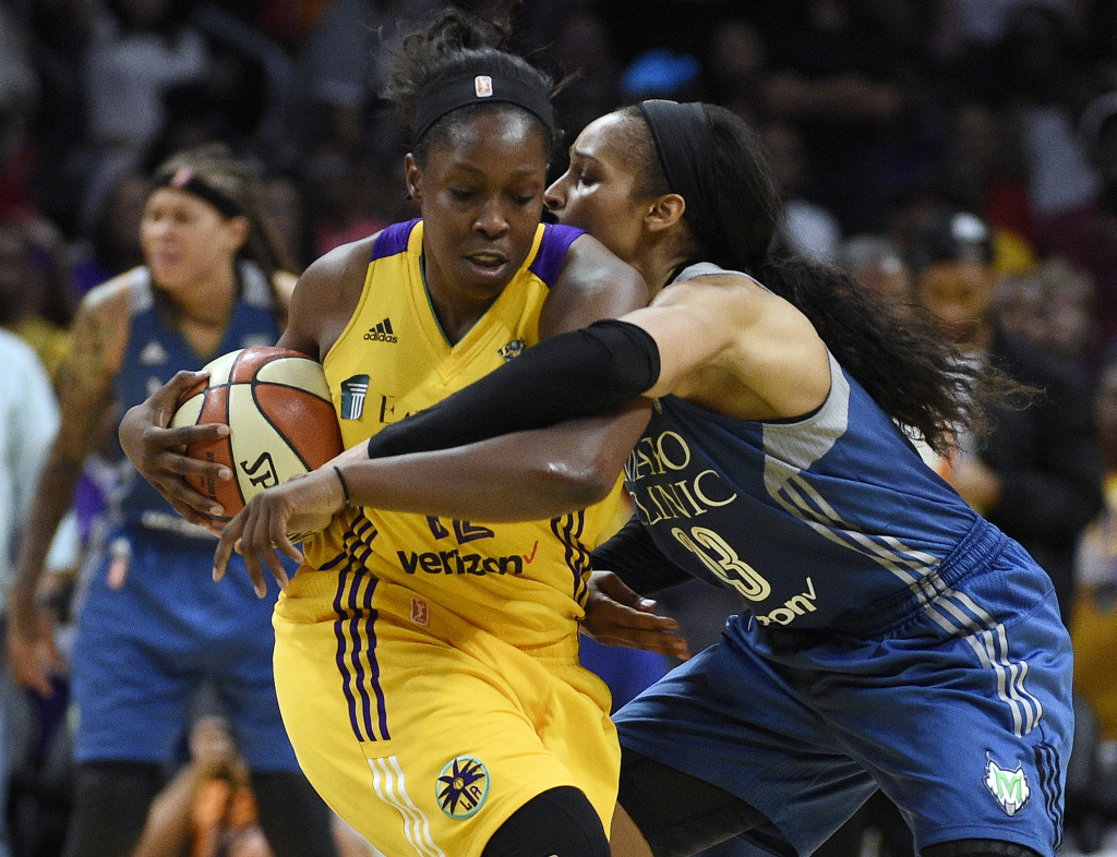 Chelsea Gray #of the Los Angeles Sparks is fouled by Maya Moore of the Minnesota Lynx during the second half of Game Three of the 2017 WNBA Finals.