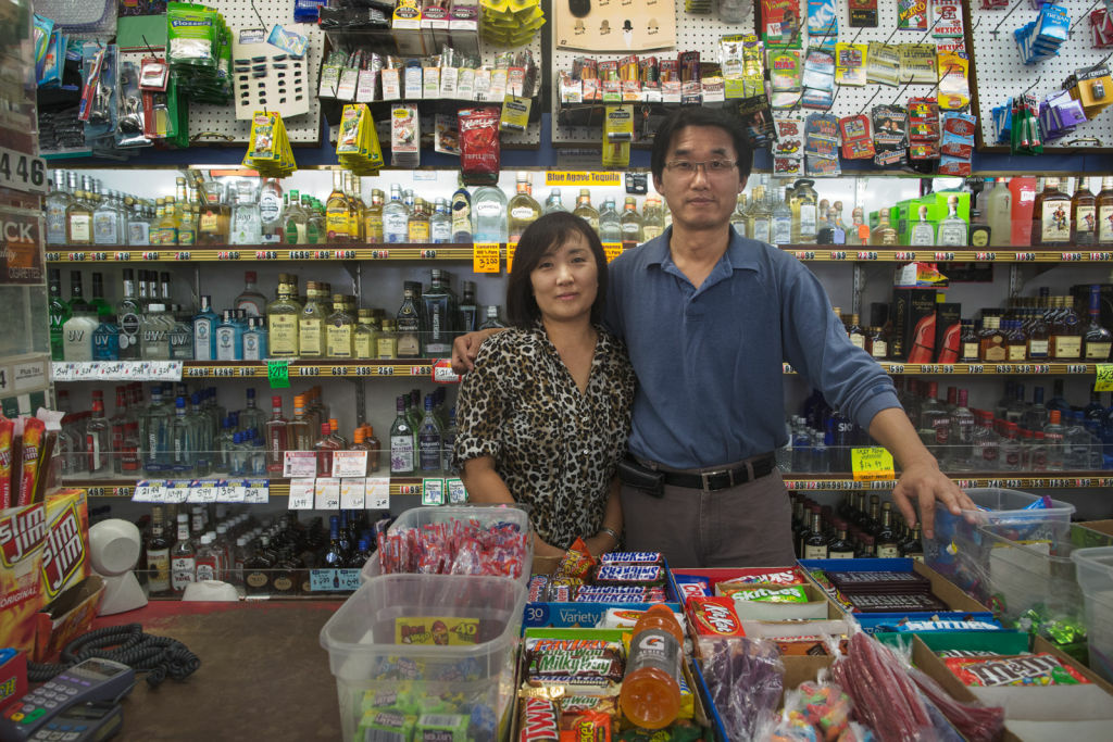 Jaeil Yoo and Sanghui Yoo own All Star liquor, which is across the street from the new Walmart Neighborhood Store. The Walmart will not initially have a liquor license and the Yoos hopes that they will be able to keep their business.