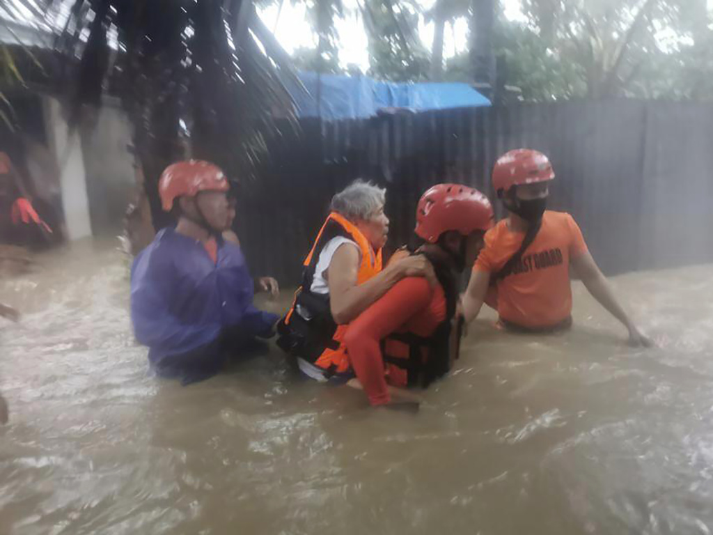 Rescuers evacuate residents to safer ground as floods caused by Tropical Storm Choi-wan hits Maasin City in Southern Leyte province, central Philippines. The tropical storm has left at least a few people dead and displaced hundreds of villagers in the southern and central Philippines.