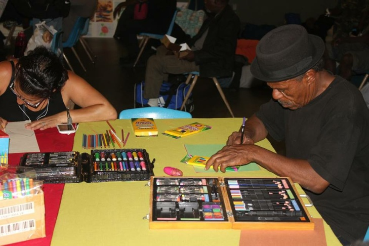Two people draw at Art With A Mission, a program held on the second Thursday of each month at the Midnight Mission in downtown L.A.