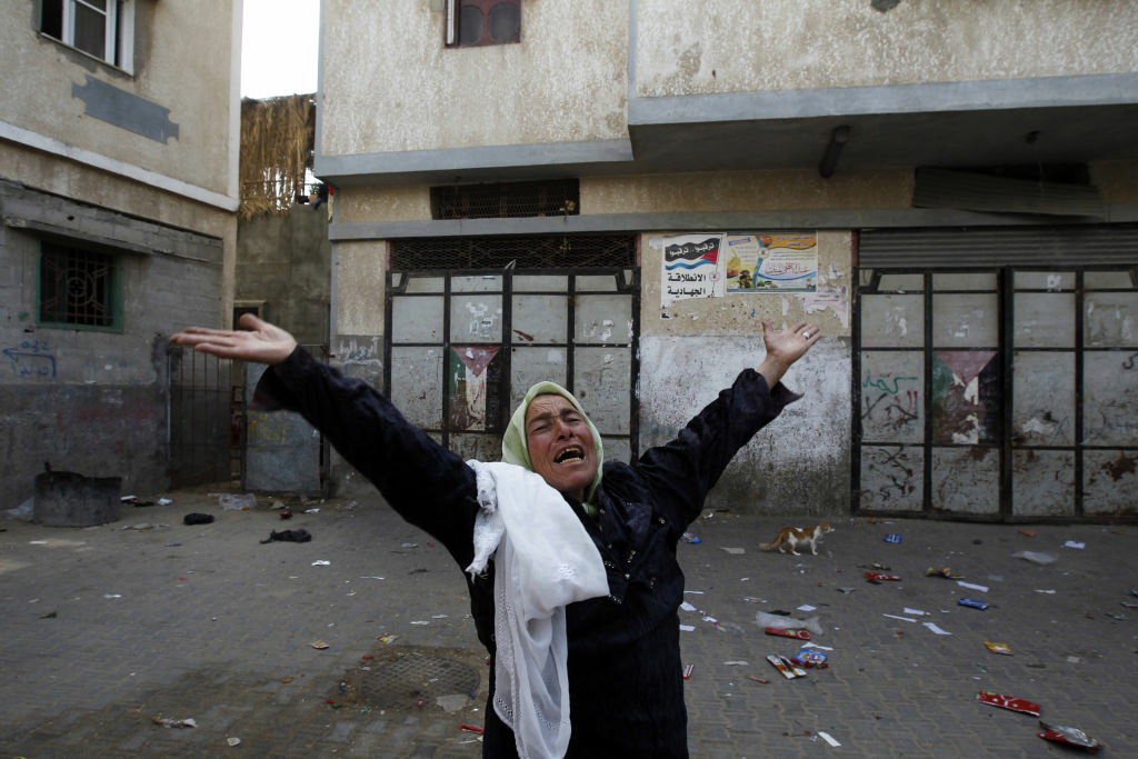 A Palestinian woman mourns after an Israeli air strike destroyed her house in the town of Jabalia, in the northern Gaza Strip, on November 19, 2012. Israeli air strikes killed 13 Palestinians on November 19, hiking the Gaza death toll to 91 as global efforts to broker a truce to end the worst violence in four years gathered pace.