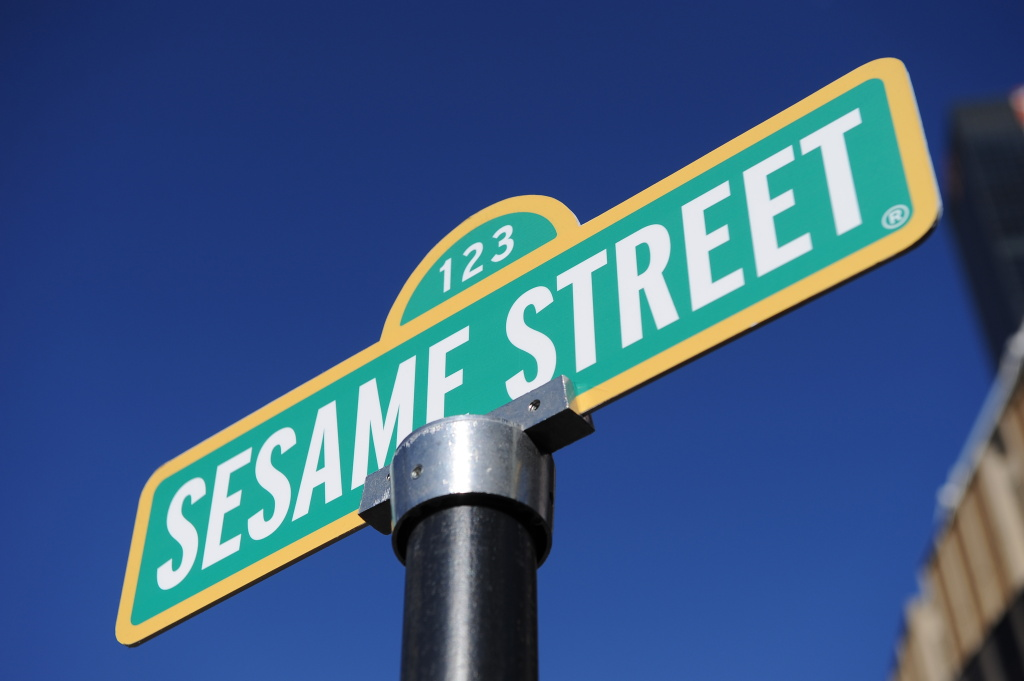 Temporary sign renaming of the corner of 31st Street and Eighth Avenue to