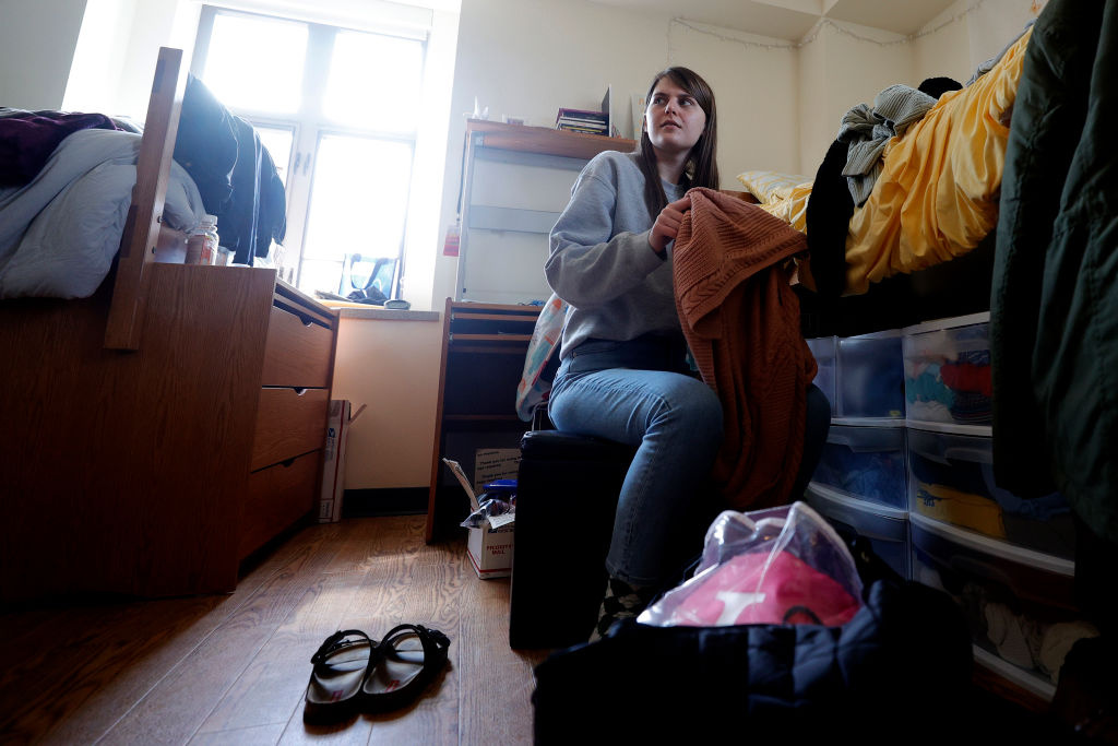 Lizzy Anderson of White Pigeon Michigan packs up and moves out of her dorm at the University of Michigan on March 17, 2020 in Ann Arbor, Michigan.