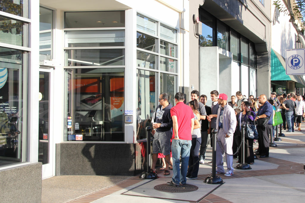 Customers line up in the early hours on Friday, September 21 at the AT&T store in Glendale, California, hoping to get a new iPhone 5. Apple wound up selling million, but Wall Street didn't care.