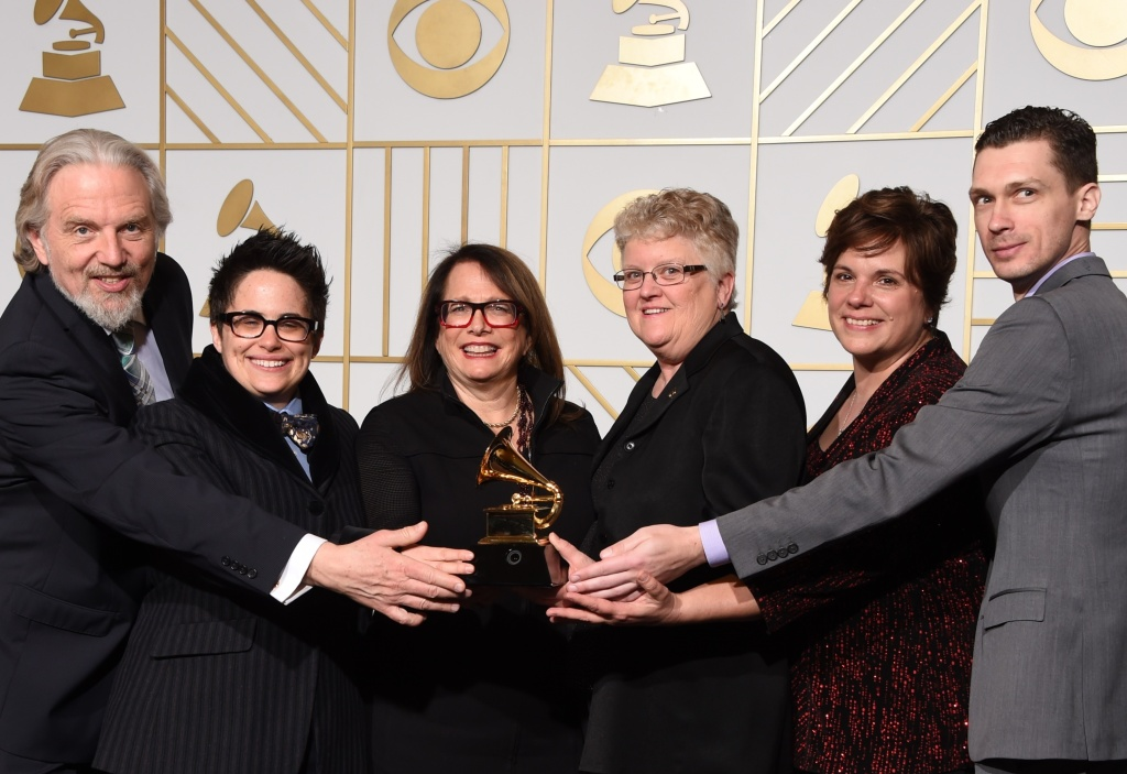 Composer Laura Karpman (center) poses with the Best Engineered Album, Classical trophy for