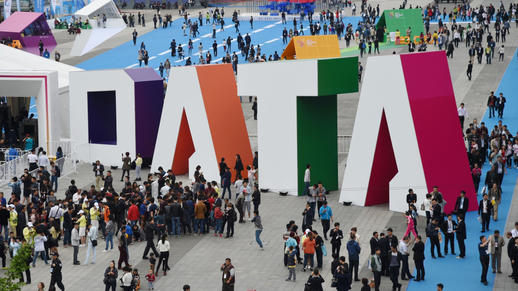 Visitors walk past the giant word