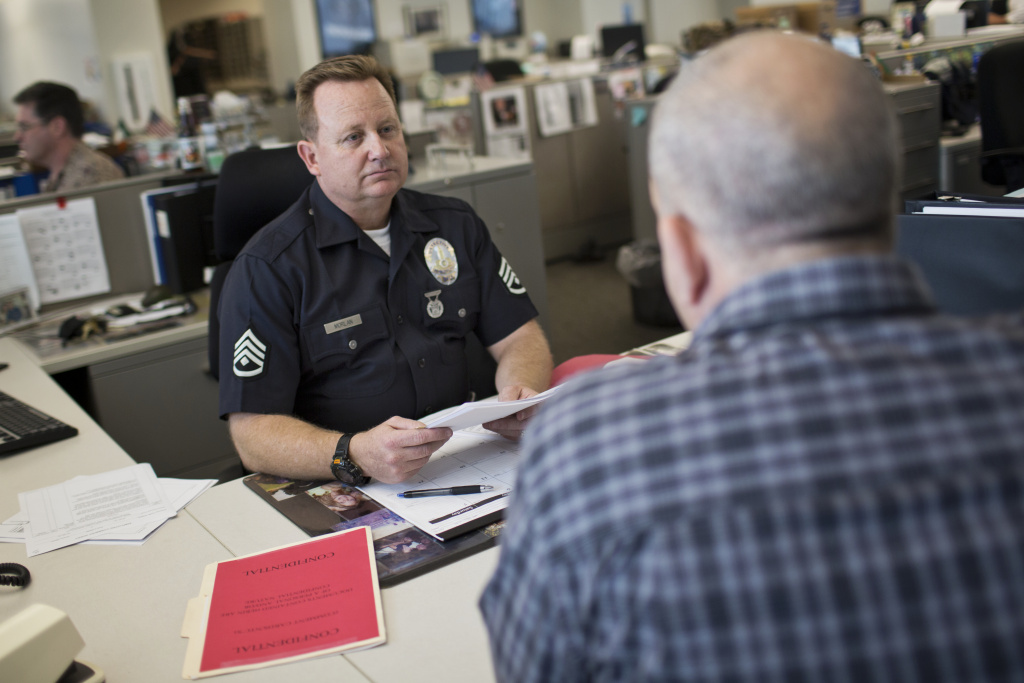 Detective Michael Morlan of LAPD speaks to a citizen. LAPD has proposed what is thought to be the nation's first Family Liaison Program.