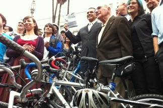 Bike enthusiasts and Mayor Antonio Villaraigosa (center) celebrate the new LA city bike plan outside City Hall on March 2, 2011 in Los Angeles.