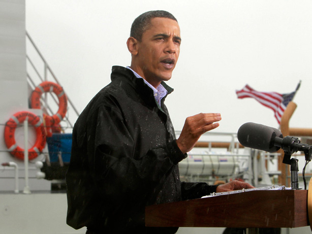 President Obama, standing in the rain, makes a statement to reporters in Venice, La., as he visits the Gulf Coast region affected by the oil spill on Sunday.