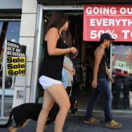 Shoppers walk past a  clothing store going out of business in Los Angeles on September 28, 2010.