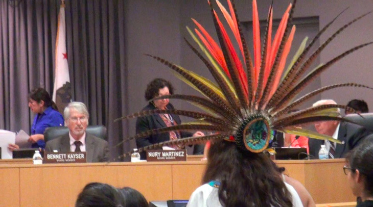 School supporter in Aztec headdress at LAUSD Board meeting