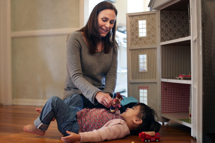 Tamar Chateff and 2-year-old Charlotte play together in their West Hollywood home on Friday, March 28. Chateff took in Charlotte as a 10-day-old foster child and has since adopted her.