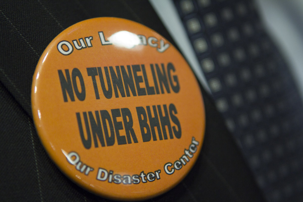 Opponents of the station at Constellation Boulevard, which would require tunneling under Beverly Hills High School, wore orange pins at a recent meeting.