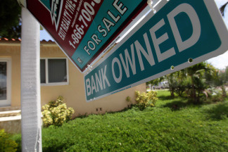 Today, the nation's largest bank - Bank of America - says it will temporarily halt the sales of foreclosed properties in all 50 states as it reviews how it handled foreclosures.