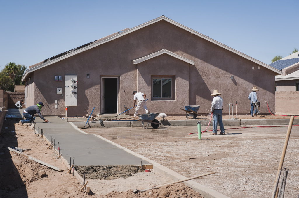 A construction crew works on a new single-family home on the Fort Yuma Indian Reservation in California, where the Quechan Tribe is using a new tax credit program to fund construction of a 44-unit affordable housing project.