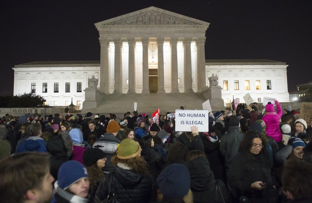 Demonstrators protest against US President Donald Trump and his administration's ban of travelers from 7 countries by Executive Order, during a rally outside the US Supreme Court in Washington, DC, on January 30, 2017.