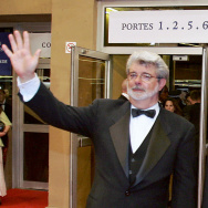 "US director George Lucas (L) and Darth Vader wave at spectators at the end of the screening of their film ""Star Wars : Episode III - Revenge of the Sith"", 15 May 2005 at the 58th edition of the Cannes International Film Festival."