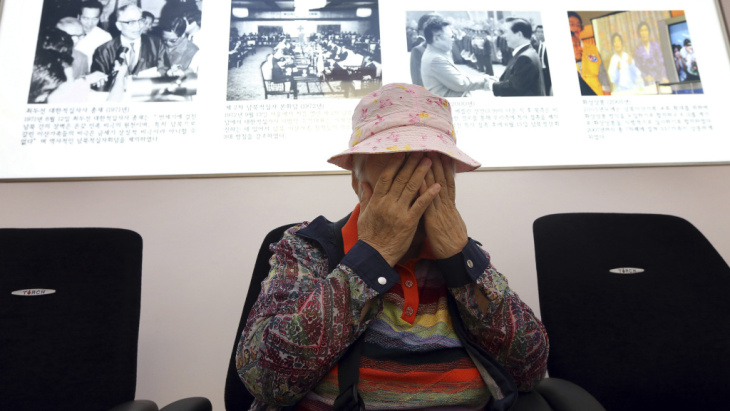 South Korean Cho Jang-geum, 81, weeps as she fills out an application to reunite with family members who live in North Korea, at the headquarters of the Korean Red Cross in Seoul Saturday. North Korea announced today that it is indefinitely postponing the