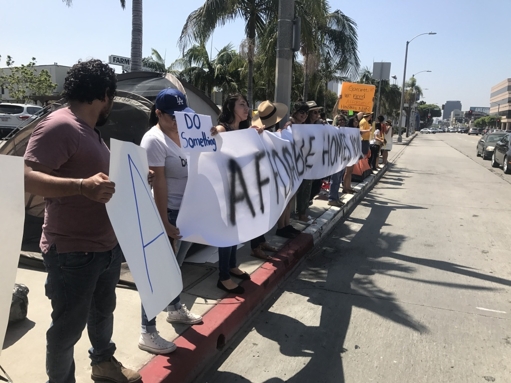 Activists lined the street at South Fairfax and 3rd street in front of the Grove this morning as part of a protest against rising homelessness and L.A.'s affordable housing crisis.