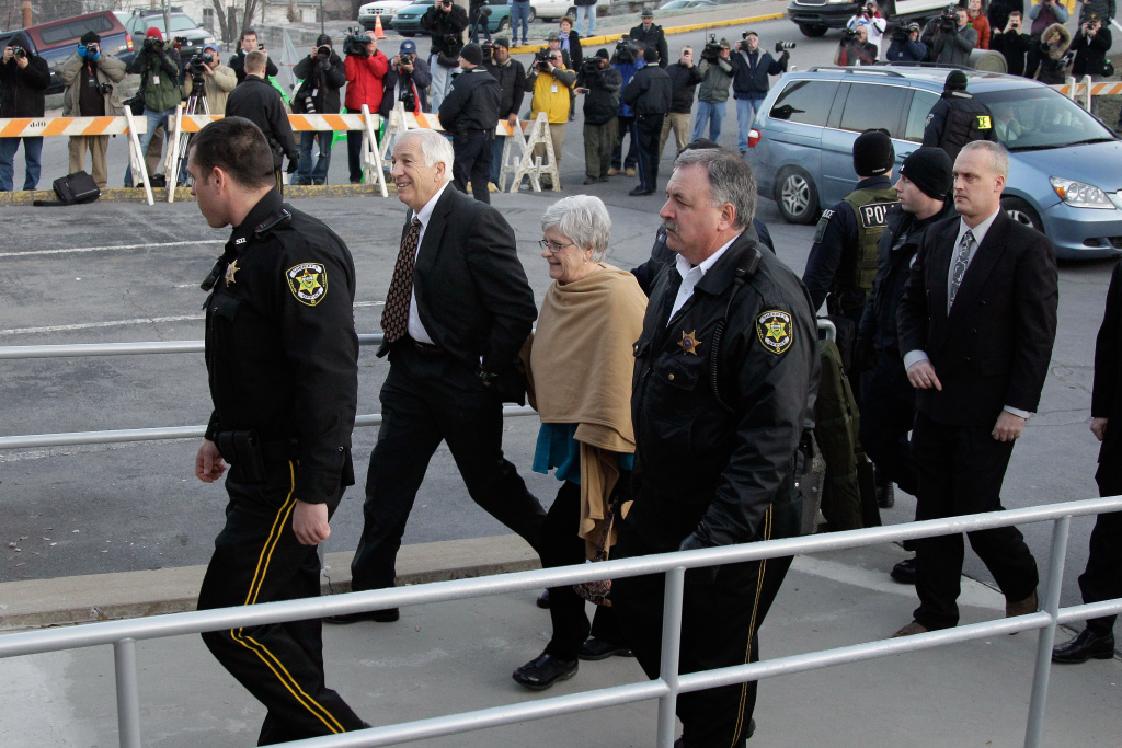 Former Penn State assistant football coach, Jerry Sandusky and his wife Dottie arrive at the Centre County Courthouse on December 13, 2011 in Bellefonte, Pennsylvania.