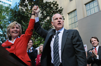 California Attorney General and democratic gubernatorial candidate Jerry Brown (R) and U.S. Sen. Barbara Boxer (D-CA) raise their arms during a campaign rally at the Los Angeles public library on November 1, 2010 in Los Angeles, California. With one day to go until election day, Jerry Brown is wrapping up his three day campaign trip throughout California in hopes of defeating his republican challenger and former eBay CEO Meg Whitman.